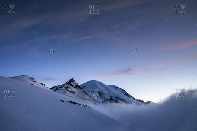 Majestic winter scenery of Little Tahoma Peak and Mount Rainier at sunset, Mount Rainier National Park, Washington State, USA