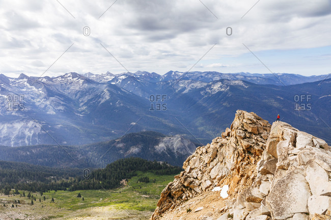 Majestic scenery with distant female hiker at summit of Alta Peak in Sequoia National Park, California, USA