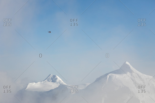 Helicopter flying above scenery with majestic mountains in Denali National Park, Alaska, USA