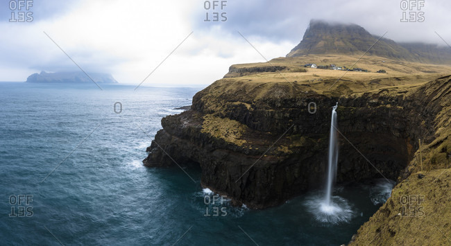 View of the famous Gasadalur waterfall in Faroe Islands.
