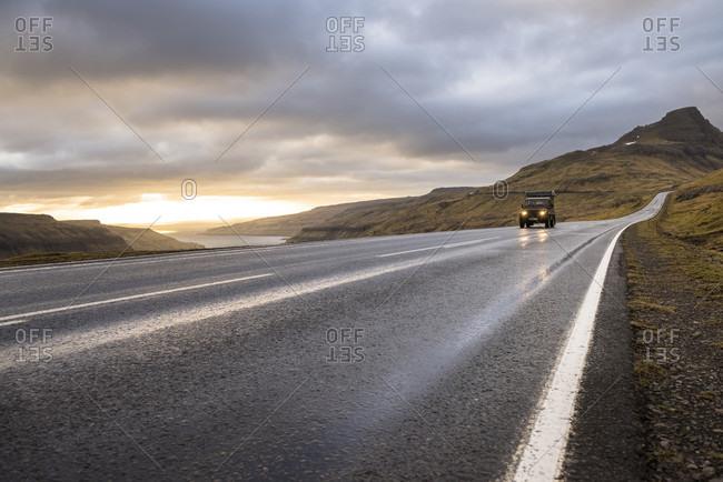Traveling the open road in the Faroe Islands.