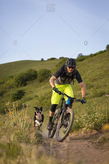Logan Whitehead and Kona the trail dog on the Bonneville Shoreline Trail