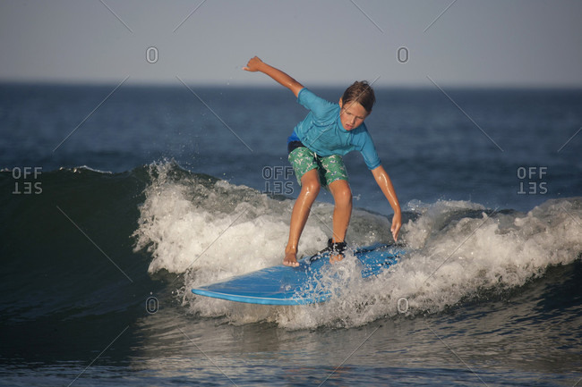 A ten-year-old boy surfs at Nahant Beach in Nahant, Massachusetts.