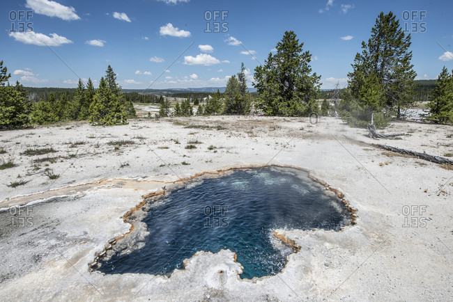 Scenery with thermal pool on Firehole Lake Loop Drive in Yellowstone National Park, Wyoming, USA