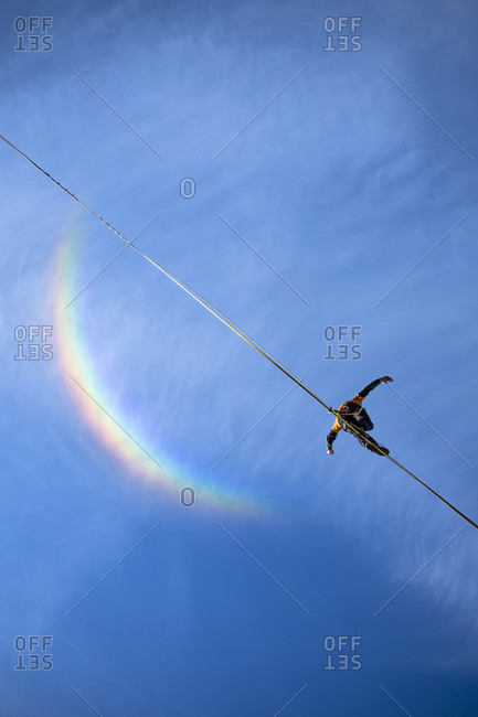 Low angle view of person walking on high line against blue sky, Upper Austria, Austria