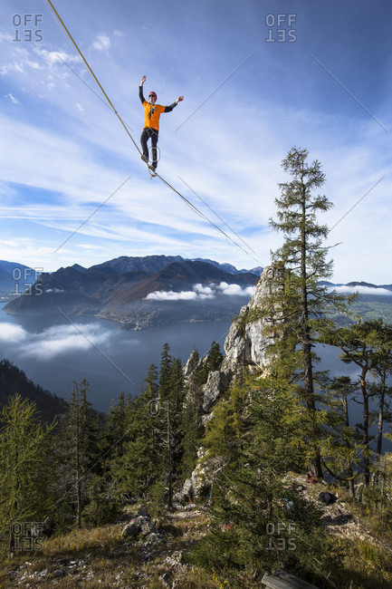 Person walking on high line above Traunsee lake in Upper Austria, Austria