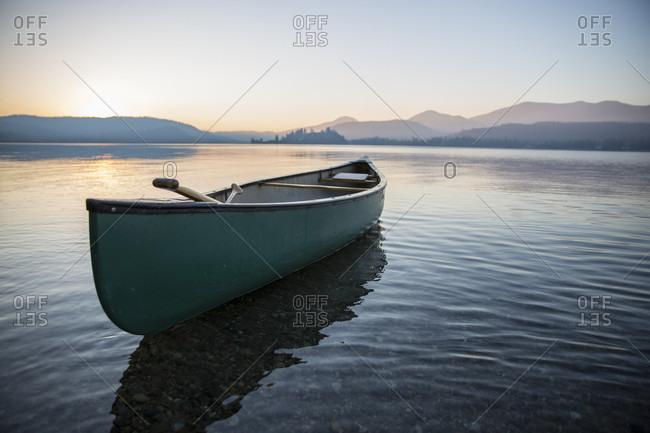 Lone canoe floating on Lake Pend Oreille, Sandpoint, Idaho