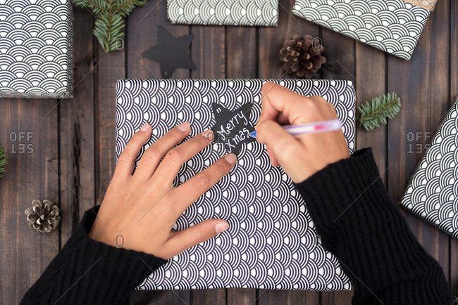 Woman making handmade craft christmas gifts on the table