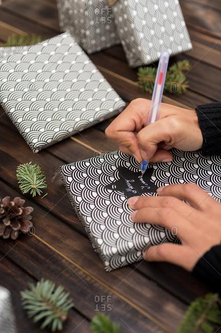 Woman making handmade craft christmas gifts on the table