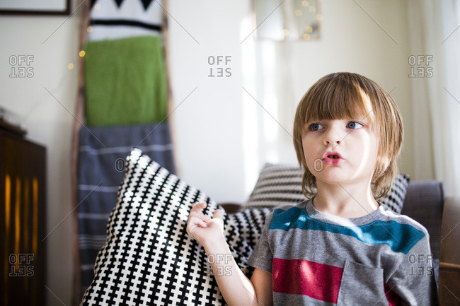 Young boy talking and gesturing