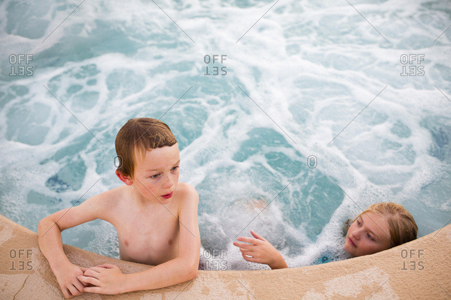 Young boy and girl in a hot tub