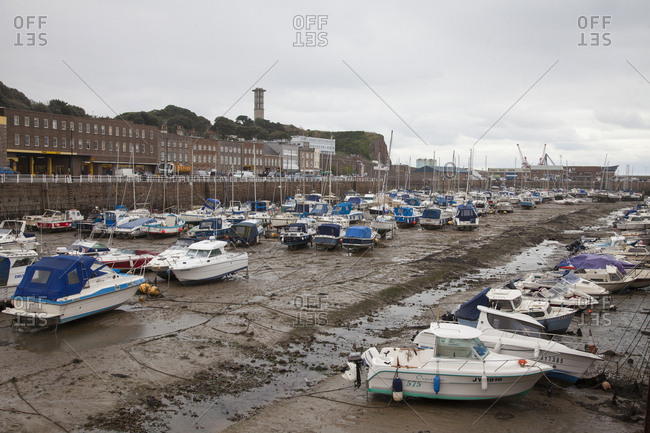 Island of Jersey, Channel Islands - November 30, 2017: Moored boats in the Marina harbor during low tide