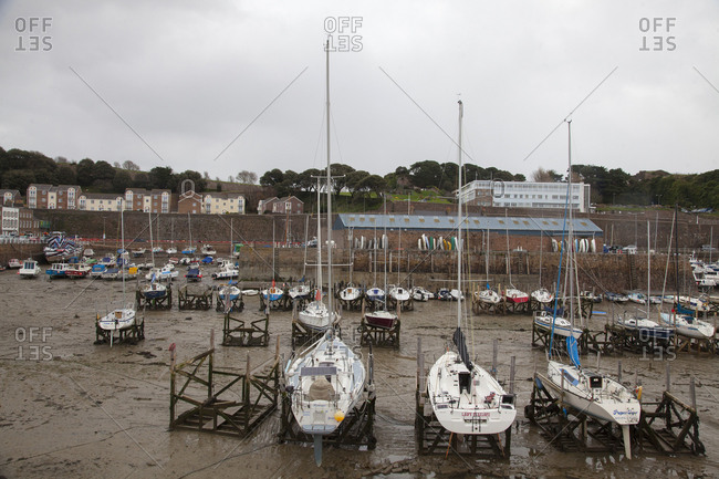 Island of Jersey, Channel Islands - November 30, 2017: Sailboats in the Marina harbor during low tide