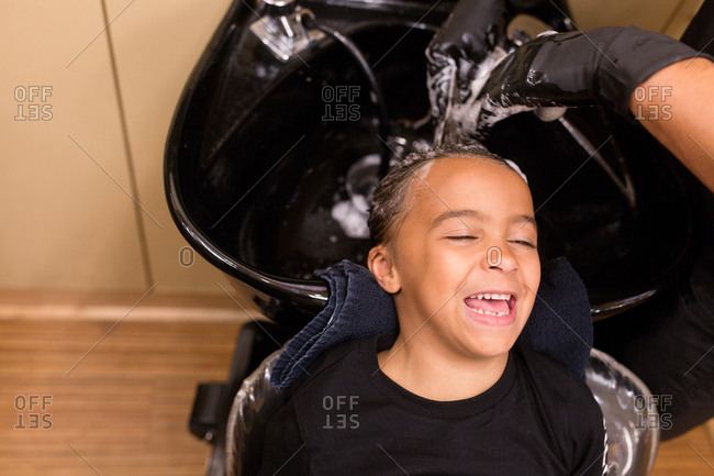 Girl having hair washed in a salon