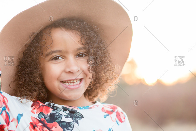 Happy little girl playing outside in dress up clothes