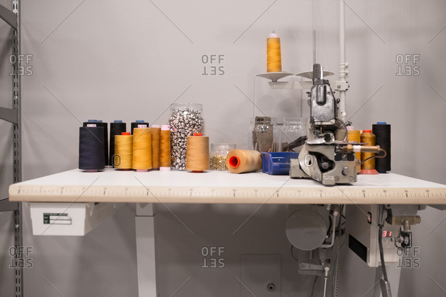 Spools of thread and buttons in a workshop