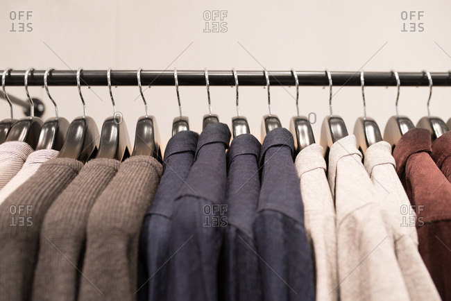 Shirts on a clothing rack in a store