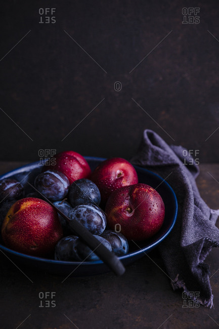 Bowl of wet stone fruits