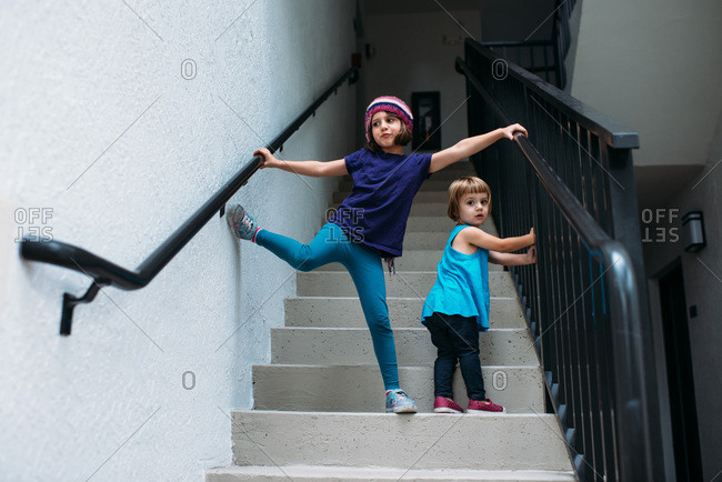 Little girls playing on stairs outside