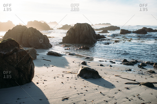 Sunset over rocky tide on Pebble Beach in California