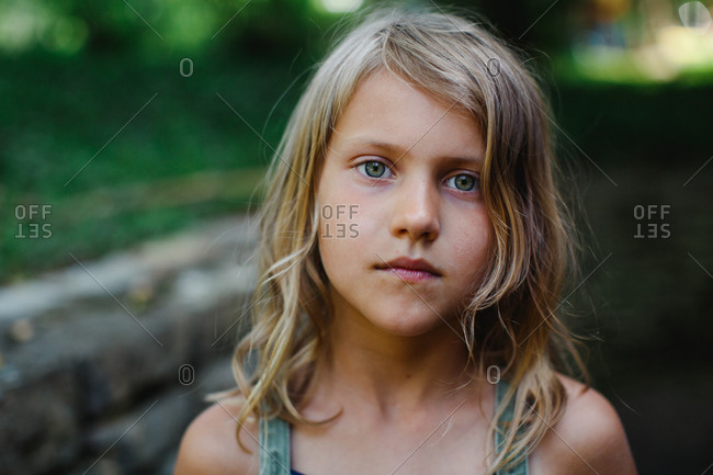 Portrait of child standing outside