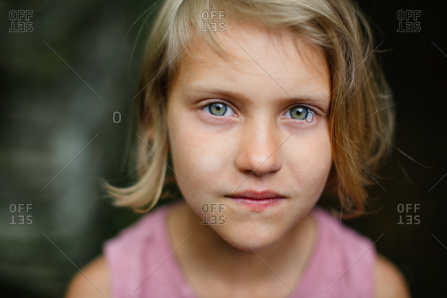 Portrait of serious child standing outside