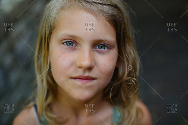Close up of girl standing outside