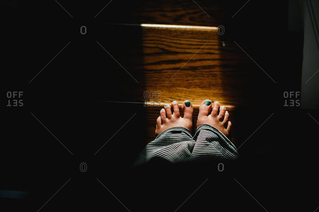 Bare feet on edge of steps