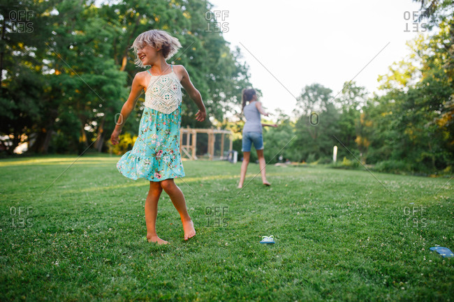 Playful children dancing outside