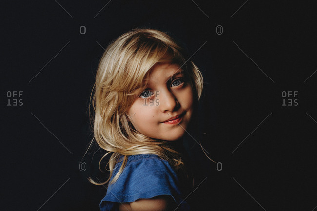 Close-up side portrait of young girl