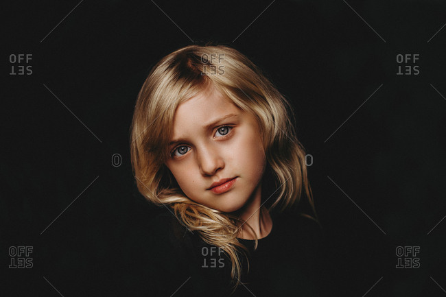 Close-up portrait of young girl tilting head
