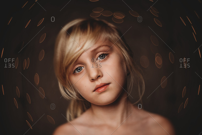 Dreamy portrait of girl with lights
