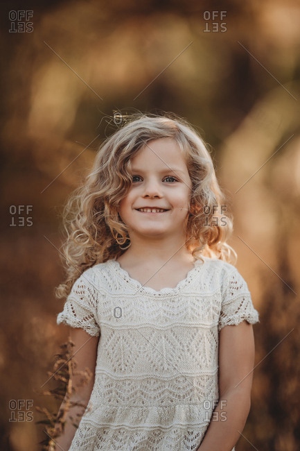 Portrait of girl smiling outside