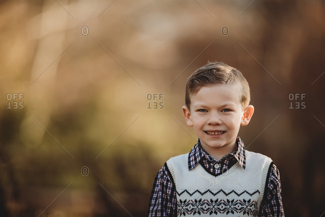 Portrait of boy smiling outside
