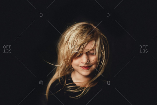 Girl with eyes closed and hair in face