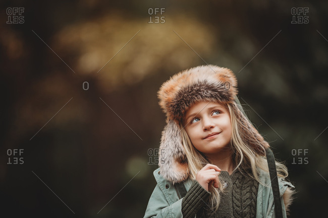 Playful girl smiling to side outside