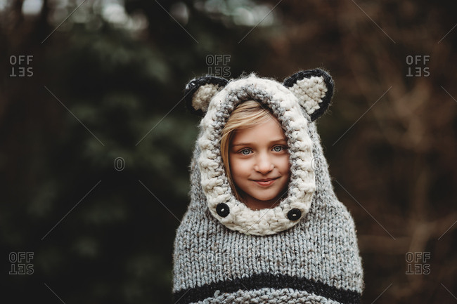 Girl wearing sweater with knitted ears