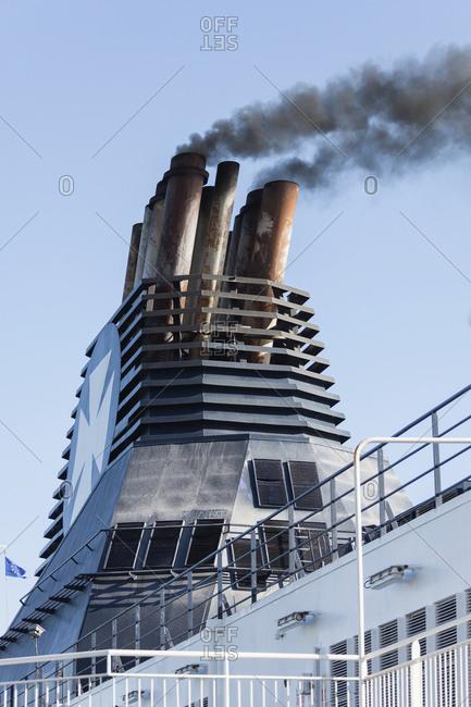 Dover, England, UK, Europe - June 18, 2017: Ferry emitting smoke
