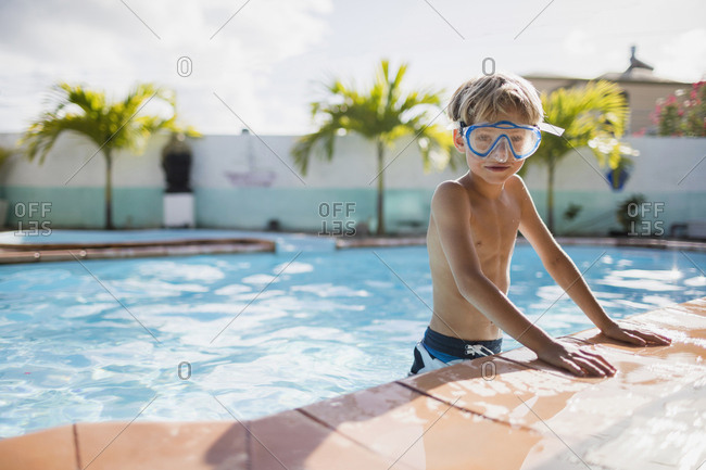 Boy with diving mask in the pool