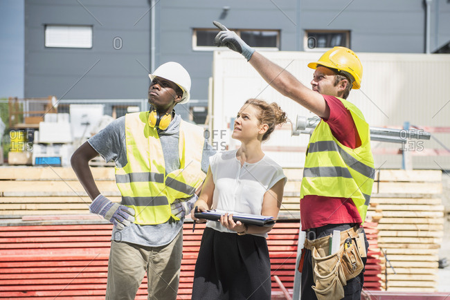 Architect with construction worker at building site