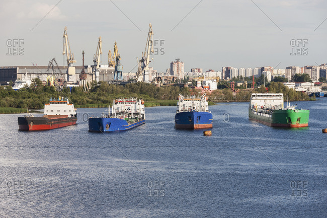 Oil tanker ships and cranes at Merchant's Harbor, Saint Petersburg, Russia