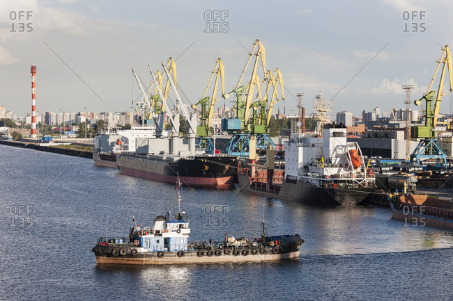 Boat and cranes at Merchant's Harbor, Saint Petersburg, Russia