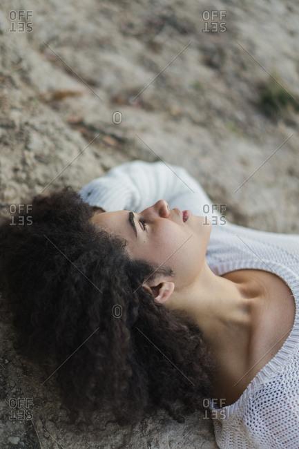 Woman lying on stone