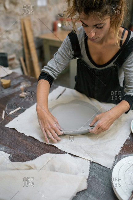 Woman working with clay at desktop