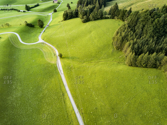 Drone perspective of countryside rural road in Alps in Austria