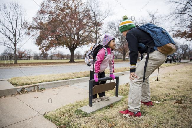 Kids having fun waiting for school bus