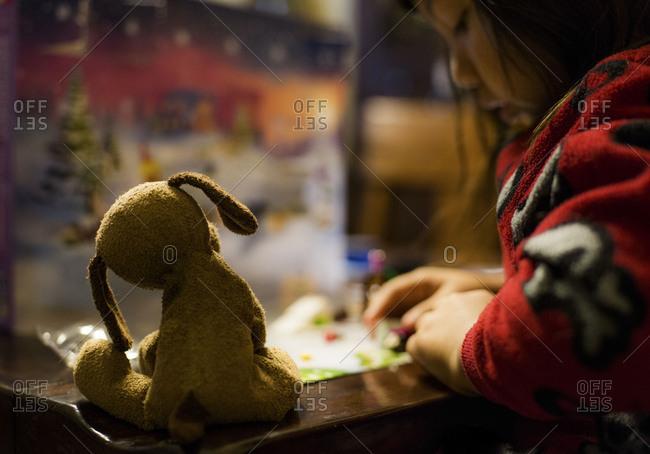 Young girl checks advent calendar