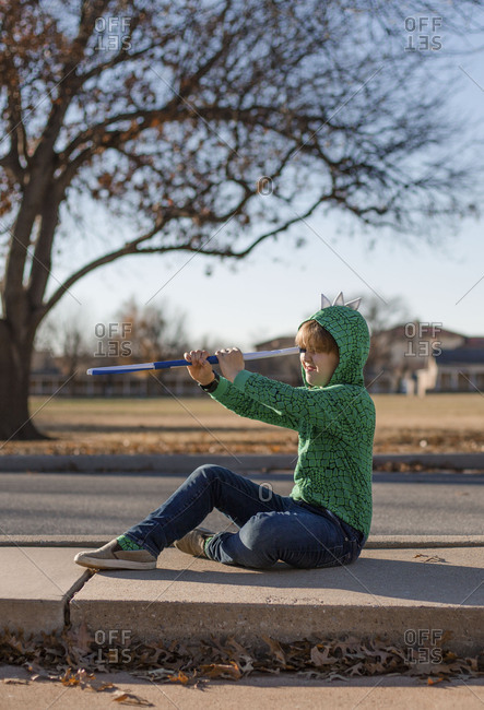 Boy playing pretend with telescope