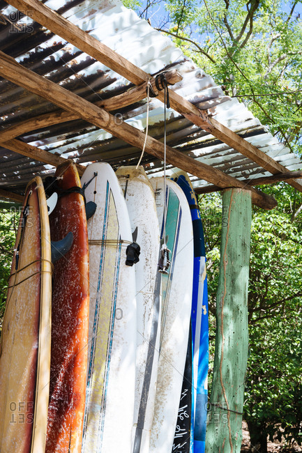 Playa Maderas, San Juan del Sur, Nicaragua - March 11, 2017: Surfboards standing in a rack
