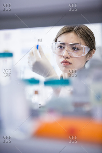 Lab assistant wearing safety goggles